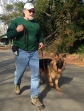 German Shepherd Gus and his guardian taking a neighborhood walk with the confidence of training the Kabler way.
